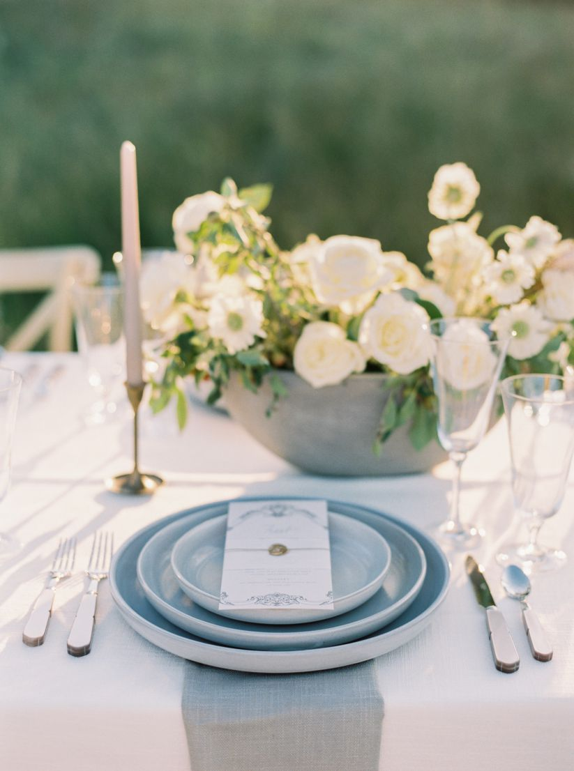 wedding shoot table, plating, silverware, and flowers