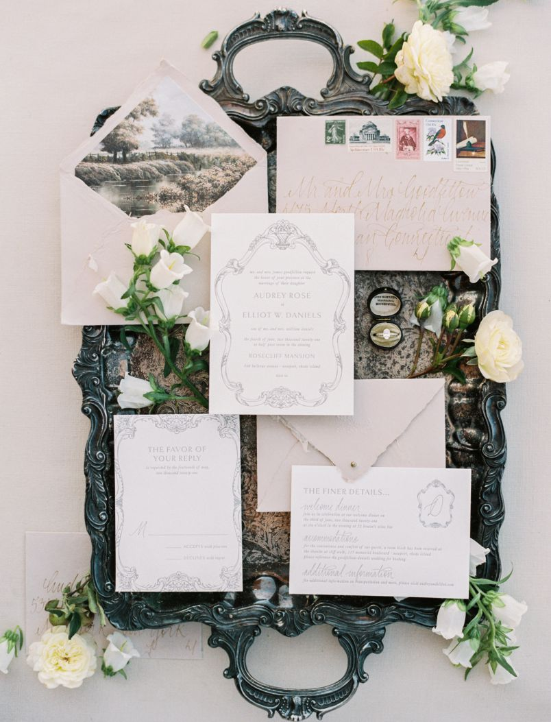 wedding invitation and accessories on silver platter