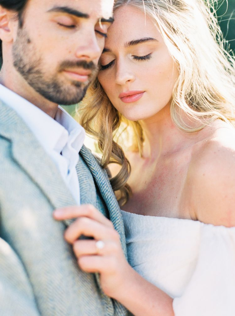 close up of groom and bride with natural makeup, red lipstick