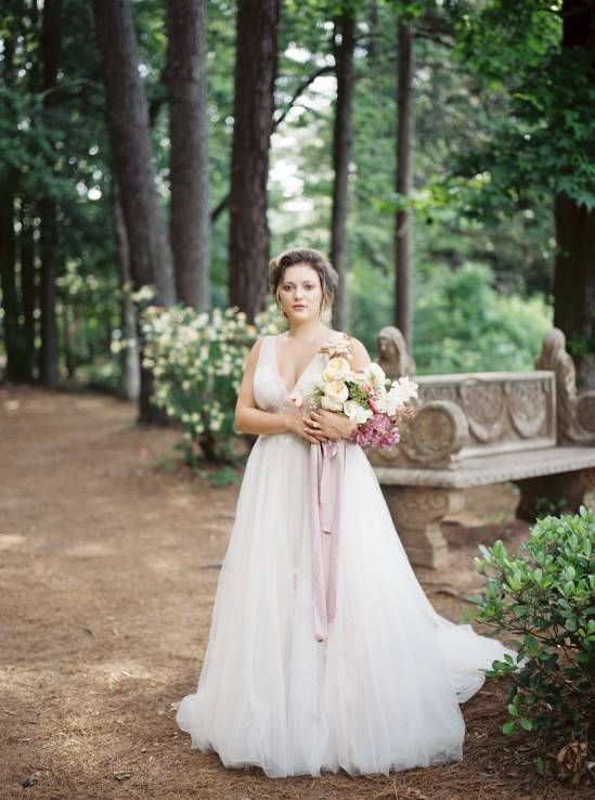 bride holding her bouquet in the woods