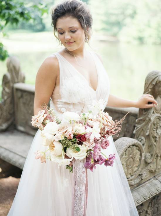 bride holding bouquet and smiling