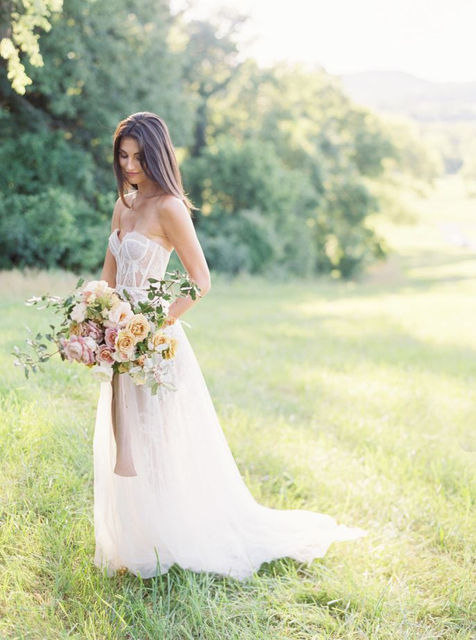 bride in white wedding dress with bouqet