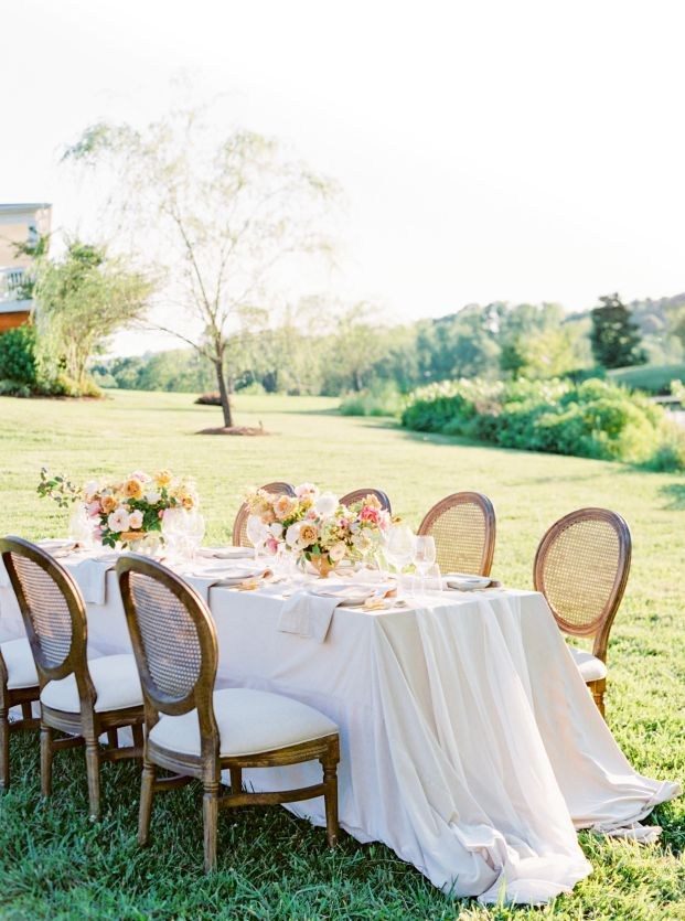 simple wedding dining table in grass field