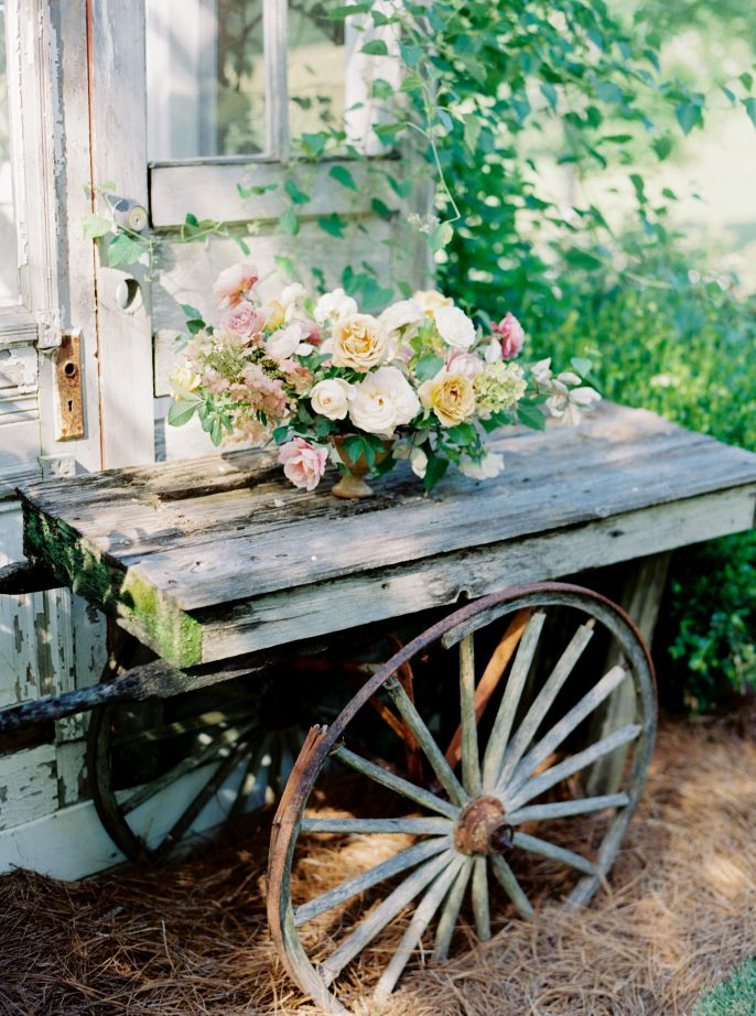 bridal bouqet sitting on old cart