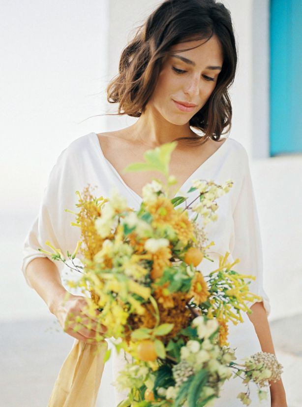 bride with bouquet displaying hair and soft makeup