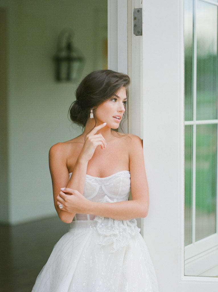 bride leaning against door
