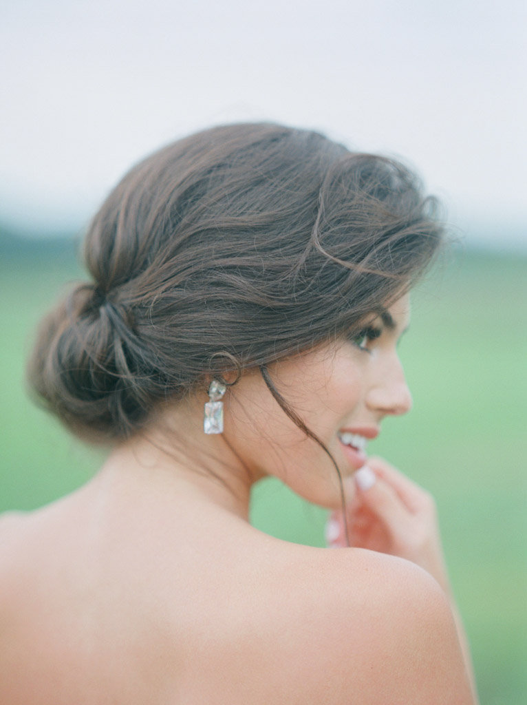 natural bridal hair styling and diamond earrings